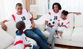 Afro-american family watching a football match Royalty Free Stock Image