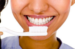 Afro-american girl brushing her teeth Royalty Free Stock Images