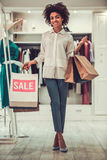 Afro American girl doing shopping Stock Images