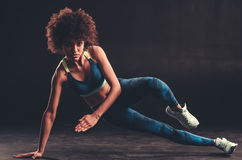 Afro American girl doing sport stock photos