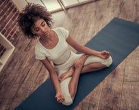 Afro American girl doing yoga Stock Photos