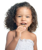 Afro american girl eating a chocolate cookie Stock Photos
