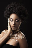 Afro-American girl with golden patterns Stock Photo