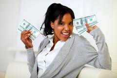 Afro-american girl holding plenty of cash money stock photos