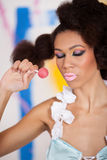 Afro american girl with lollipop Stock Photography
