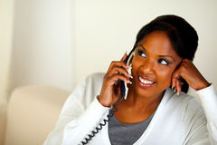 Afro-american girl looking to her right on phone Royalty Free Stock Image