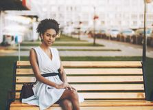 Afro American girl on the street bench stock photo