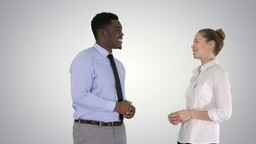 Afro american guy and girl talking about business on gradient background. stock photography