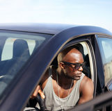Afro american guy sitting in his car Royalty Free Stock Images