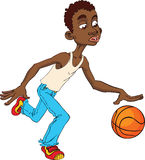 Afro American kid playing basketball. Royalty Free Stock Image