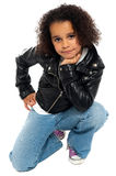 Afro American kid posing stylishly to the camera. All on white background Royalty Free Stock Photo