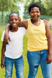 Afro american kids together outdoors. Stock Images