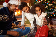 Afro American little girl opening Christmas present Stock Photography