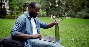 African-american Male in Park with Laptop stock video footage