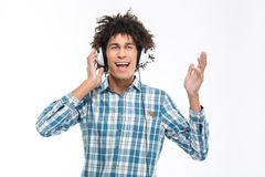 Afro american man with curly hair listening music in headphones Royalty Free Stock Photos