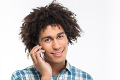 Afro american man with curly hair talking on the phone Royalty Free Stock Photo