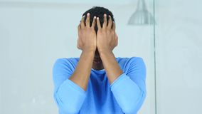 Afro-American Man in Frustration of Failure, Upset after Huge Loss. 4k , high quality Stock Photography