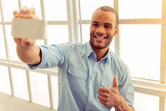 Afro American man with gadget Stock Photo