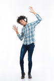 Afro american man listening  music in headphones and dancing Royalty Free Stock Photos