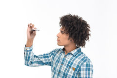 Afro american man looking on slim smartphone Royalty Free Stock Photos