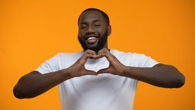 Afro-American man in love showing heart gesture, happy relations, acquaintance. Stock footage stock footage