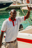 Afro-american man near the yacht Stock Image