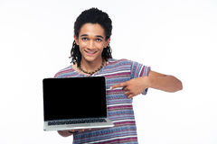 Afro american man pointing finger on blank laptop screen. Portrait of a happy afro american man pointing finger on blank laptop screen isolated on a white Stock Photo