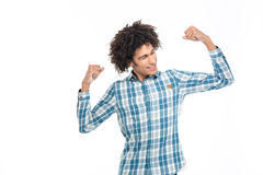 Afro american man showing his biceps Royalty Free Stock Photo