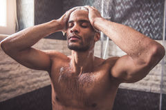 Afro American man taking shower Stock Photo