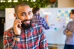 Afro american man talking on the phone in office Stock Image