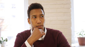 Afro-American Man in Thought, Serious Designer in Studio. High quality royalty free stock photos