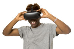 Afro american man wearing virtual reality vr 360 vision goggles enjoying video game. Young happy and excited afro american man wearing virtual reality vr 360 Royalty Free Stock Photo