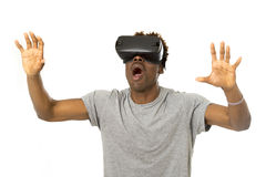 Afro american man wearing virtual reality vr 360 vision goggles enjoying video game Stock Photo