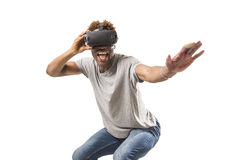 Afro american man wearing virtual reality vr 360 vision goggles enjoying video game. Young happy and excited afro american man wearing virtual reality vr 360 royalty free stock photography