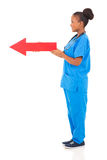 Afro american nurse arrow Royalty Free Stock Images
