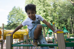 Afro american school boy plays on playground Royalty Free Stock Photo
