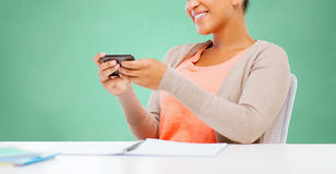 Afro american student girl with smartphone Stock Photography