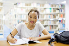 Afro american student studying. In university library Royalty Free Stock Photos