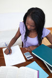 Afro-American teen girl doing her homework Stock Photos