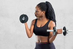 Afro american teen girl working out with dumbbells. royalty free stock photos