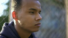 Afro-american teenage boy thoughtfully looking forward, concerned about future royalty free stock image