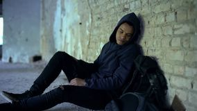 Afro-american teenager hiding from bullying in abandoned building, racism royalty free stock photo