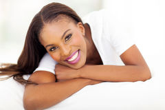 Afro american woman. Beautiful afro american woman lying on bed Stock Photography