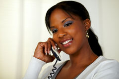 Afro-american woman conversing on phone Royalty Free Stock Photography