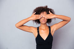 Afro american woman covering her eyes Stock Photography