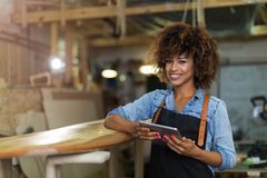 Young woman doing woodwork in a workshop Stock Image