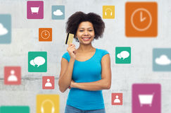 Afro american woman with credit card and icons Stock Images