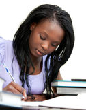 Afro-american woman doing homework at home Stock Photography
