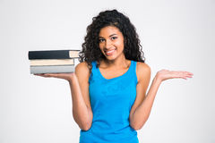 Afro american woman holding books and copyspace on the palms Royalty Free Stock Images