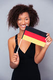 Afro american woman holding Germany flag Stock Image